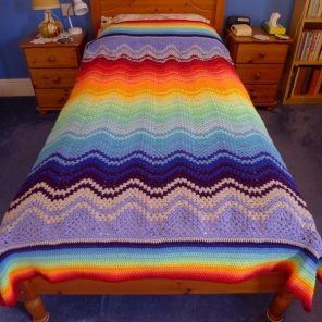 Spectrum blanket on bed