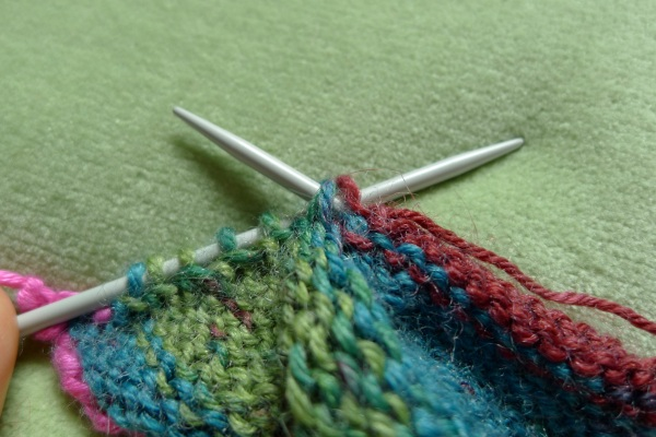Both needles through loops