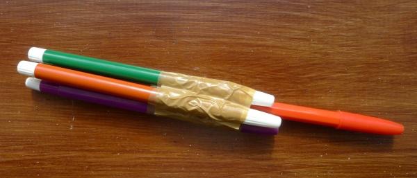 Three pens as pins