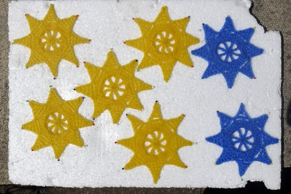 Blue & yellow stars pinned