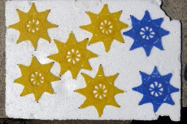 Blue & yellow stars pinned
