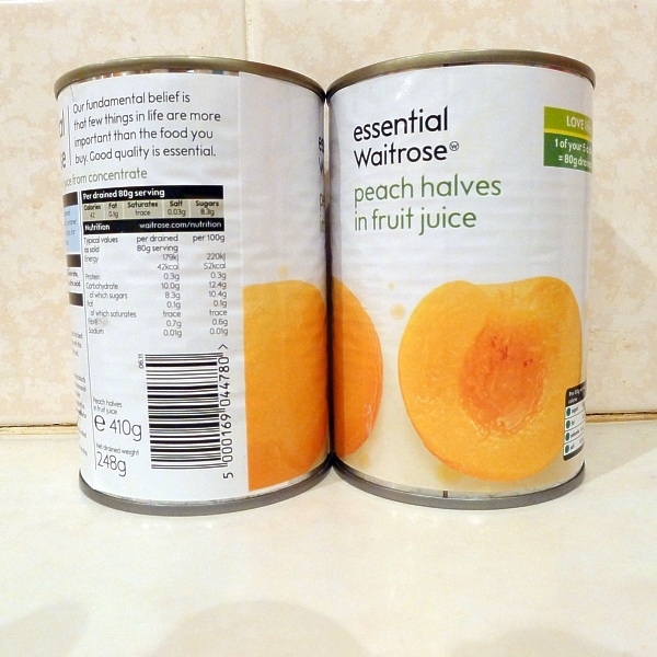Two tins of peaches