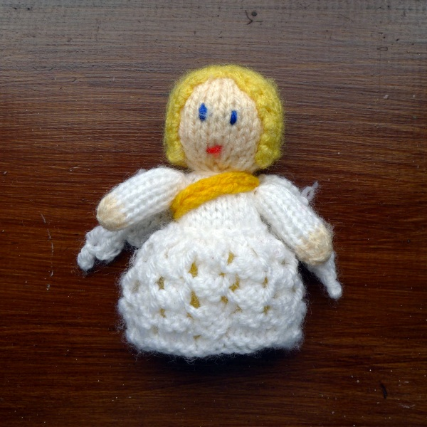 Knitted angel with sash