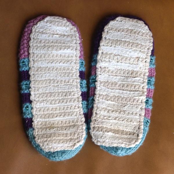 Slipper with non-stick soles
