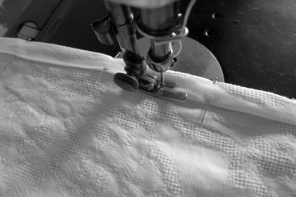 Hem being sewn