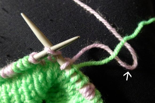 First stitch with lower yarn
