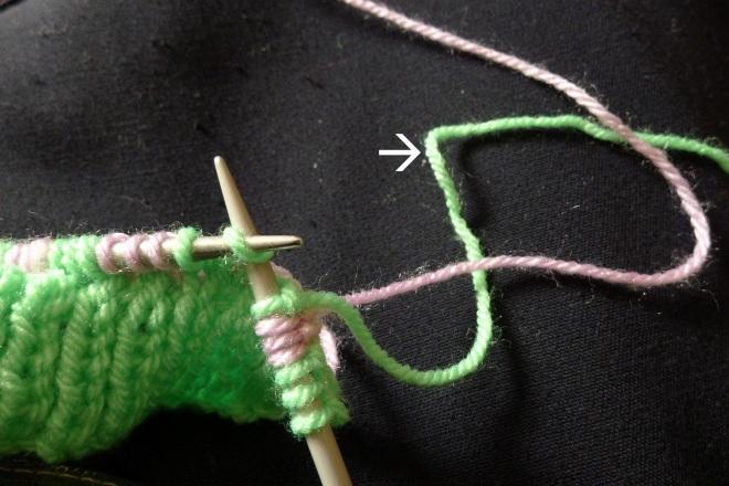 First stitch with upper yarn