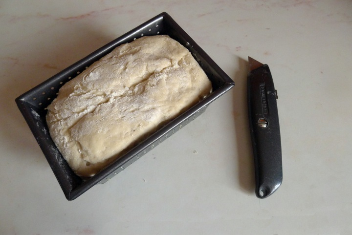 dough in tin and Stanley knife