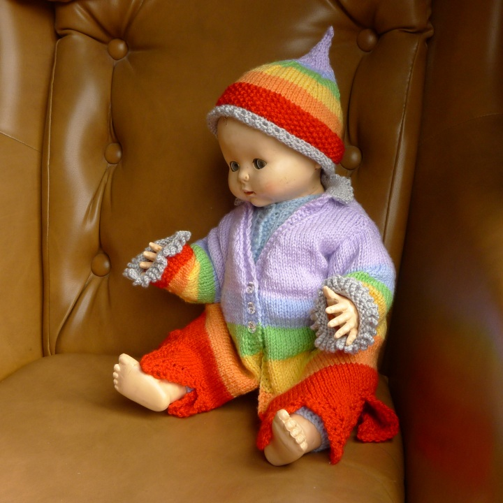 doll wearing hat and coat