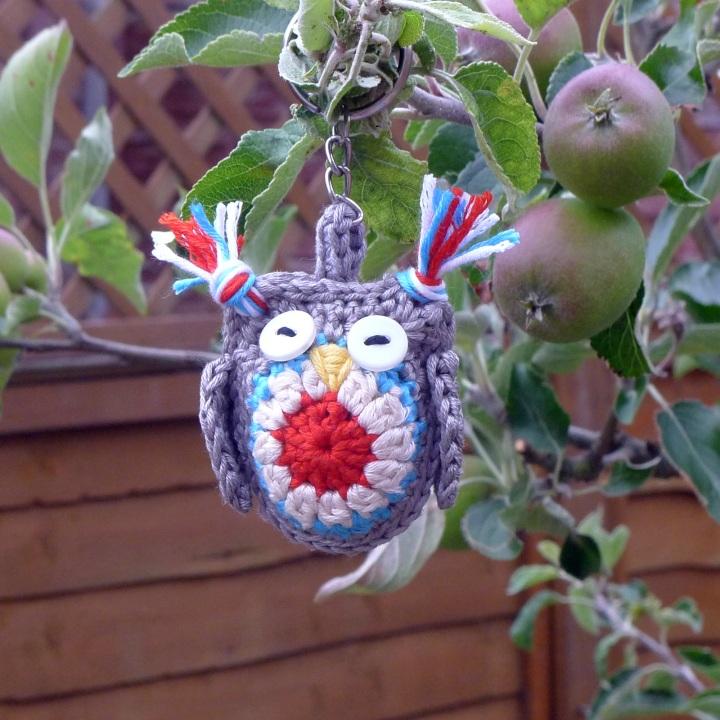 owl key-ring hanging in apple tree
