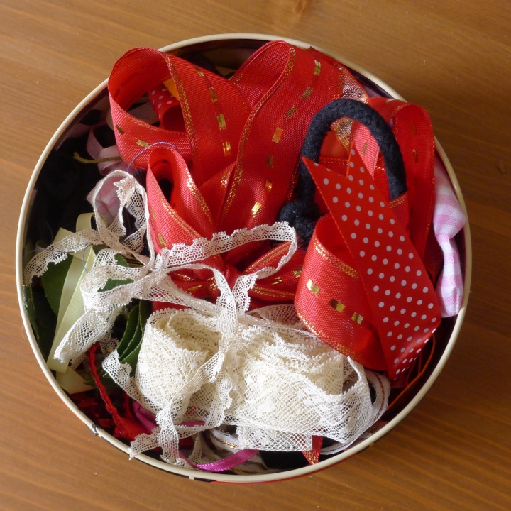 tin of ribbon and lace
