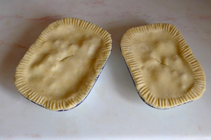 two blackberry and apple pies